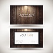 Business Card template with a frame and a wooden background.
