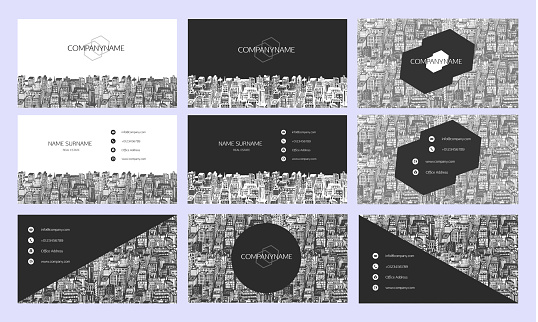 Business cards design with hand drawn cityscape background.