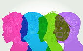 Colorful silhouettes of business people with icons suggesting conference, seminar or meeting
