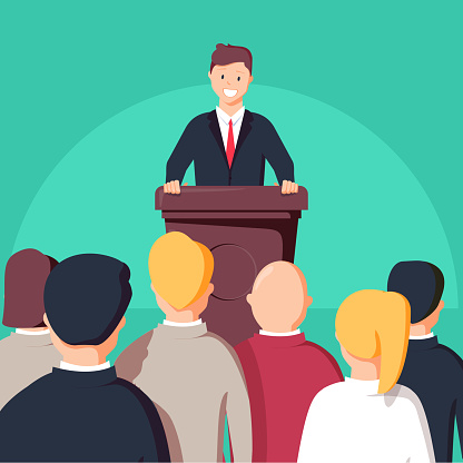 Business conference, business meeting. Man at rostrum in front of audience. Public speaker