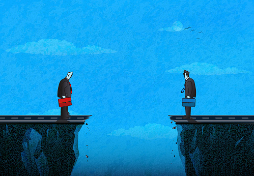 Businessmen standing on the edge of the ravine and thinking about how to meet. (Used clipping mask)