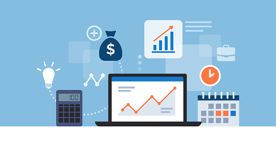 Business desktop with laptop and financial app