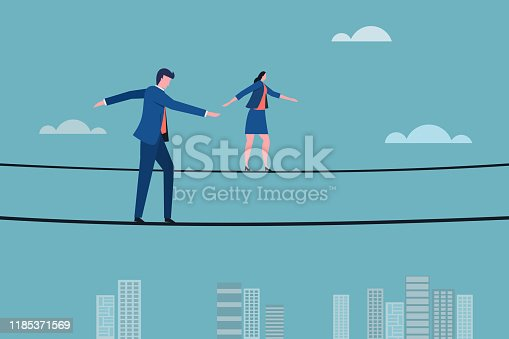 Business executives walking on a tight rope. Concept for moving ahead with risks and challenges