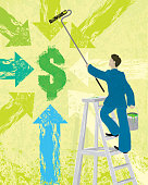 Business financial concept painting dollar sign and arrows