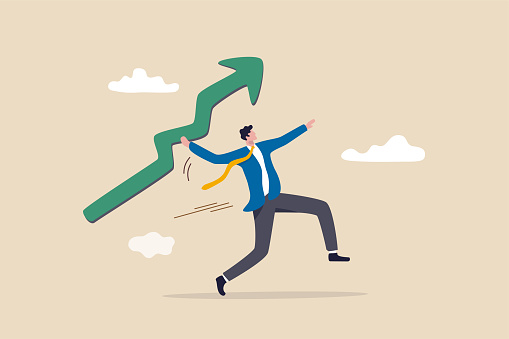 Business growth and improvement, target high profit, stock market soaring, bull market or economic prosperity concept, strong businessman throwing green rising up arrow javelin.