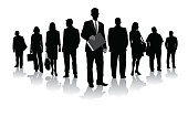 Large group of business people in silhouette and standing in a perspective line