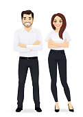 Business team. Casual business man and woman with arms crossed isolated.