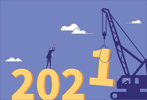 Business man directs crane installation 2021