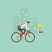 business man on bike go to work in city.energy saving