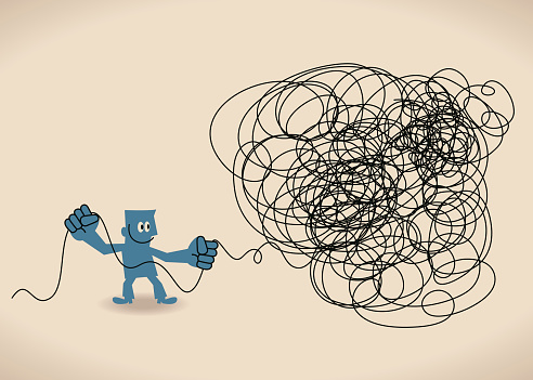 Business man untangle a tangled messy knot (string, line)