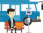 Asian business man waiting at the bus stop. Young business man sitting at the bus stop. Cheerful businessman sitting on a bus stop bench. Vector flat design illustration isolated on white background.