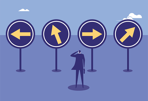Business man with direction sign, lost direction