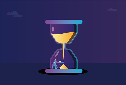A business man working in an hourglass races against time, time is money
