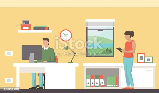 People working in a colorful modern office, a man is sitting at desk and using a computer, a woman is using a digital tablet