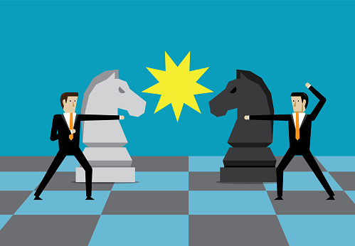Business people play chess in a business game