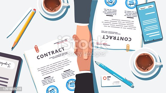 istock Business people shaking hands over paper and digital signed & stamped contract closing deal. Closeup top view of handshake partnership agreement, desk, phone, tablet, coffee. Flat vector illustration 1261666015