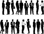 A vector silhouette illustration of many business men and business women.