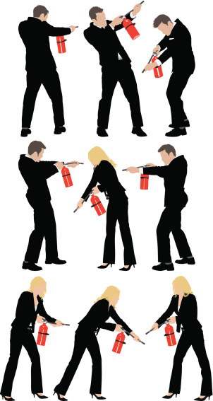 Business people using fire extinguisher