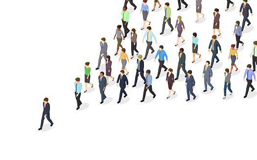 Business people walking in same direction