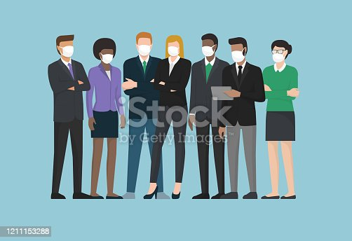 istock Business people wearing surgical masks and standing together 1211153288
