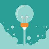 Flat design modern creative startup concept with starting lightbulb rockets.