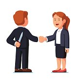 Business woman and man standing shaking hands