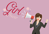 Business woman holding a megaphone with word girl power. Feminist concept