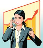 Image of a young business woman talking on the phone and giving thumbs up for healthy business performance.