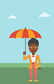 An african-american business woman standing with open umbrella on the background of blue sky. A woman under open umbrella. Happy woman with umbrella. Vector flat design illustration. Vertical layout.