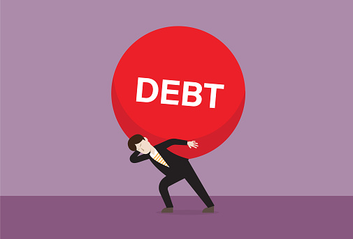 Businessman carries a debt ball