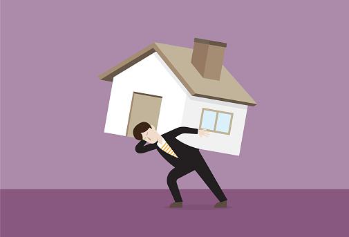 Businessman carries a house