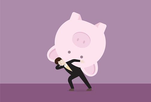 Businessman carries a piggy bank