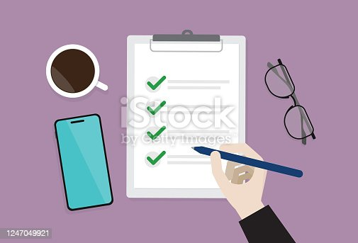 istock Businessman checking a list 1247049921