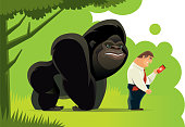 businessman checking smartphone with gorilla