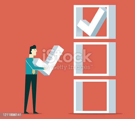 istock Businessman checking the list 1211896141