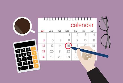 Businessman choose a date on a calendar
