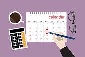 istock Businessman choose a date on a calendar 1219529898