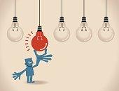 Businessman choosing the best idea (light bulb)