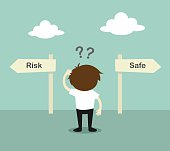 Businessman confused about two direction, between risk or safe.