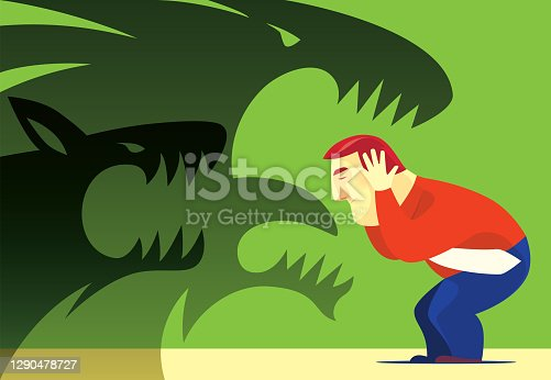 istock businessman covering ears with screaming beasts shadow 1290478727