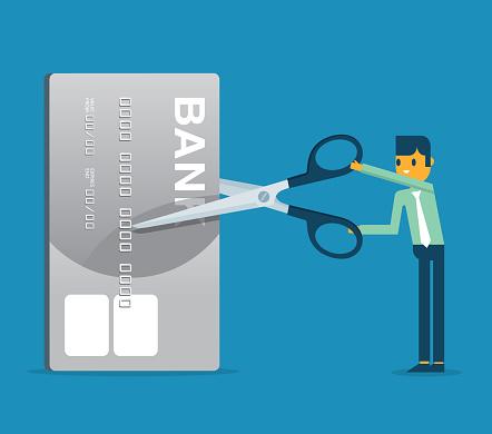 Businessman - Cutting credit card
