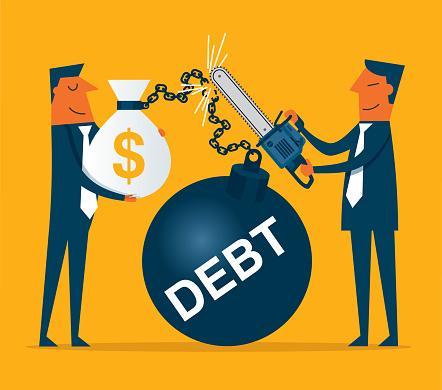 Businessman cutting debt weight chain