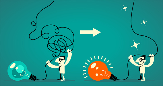 Businessman (office worker) decluttering his mind (light bulb with tangled messy electrical line) and regaining (restoring) his focus (clear thinking)