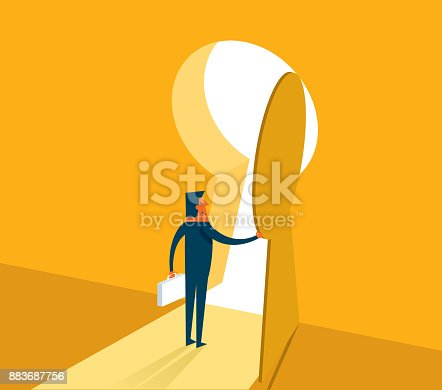 Businessman on standing looking at keyhole door