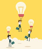 Businessman fly higher with big ideas light bulb.