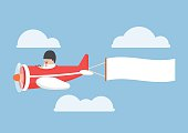 Businessman flying by the airplane with banner