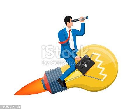 istock Businessman flying on big idea bulb formed rocket. 1257709124