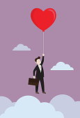 istock Businessman flying with heart balloon 1173707524