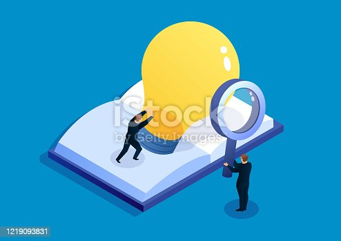istock Businessman found a shiny light bulb from the book 1219093831