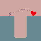 istock Businessman gets heart shaped sign opposite the trap,use a lasso. 1196566462